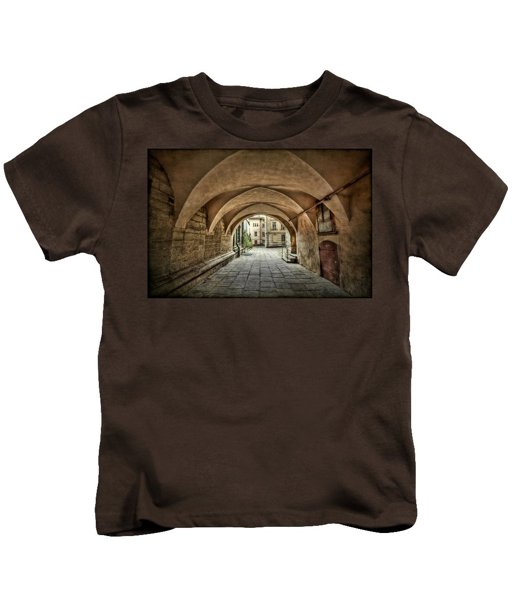 Passage Kids T-Shirt featuring the photograph Stuck In The Middle by Evelina Kremsdorf