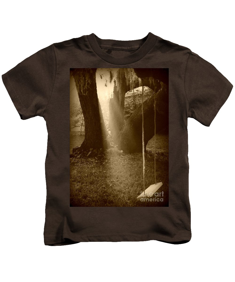 Sepia Kids T-Shirt featuring the photograph Sunlight On Swing - Sepia by Carol Groenen
