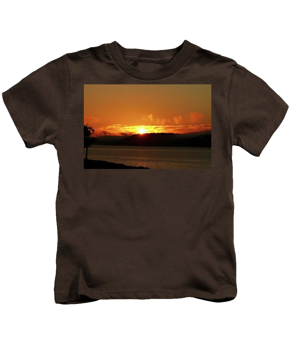 Sunrises Kids T-Shirt featuring the photograph Sunrise Over The Lake by Linda Cupps