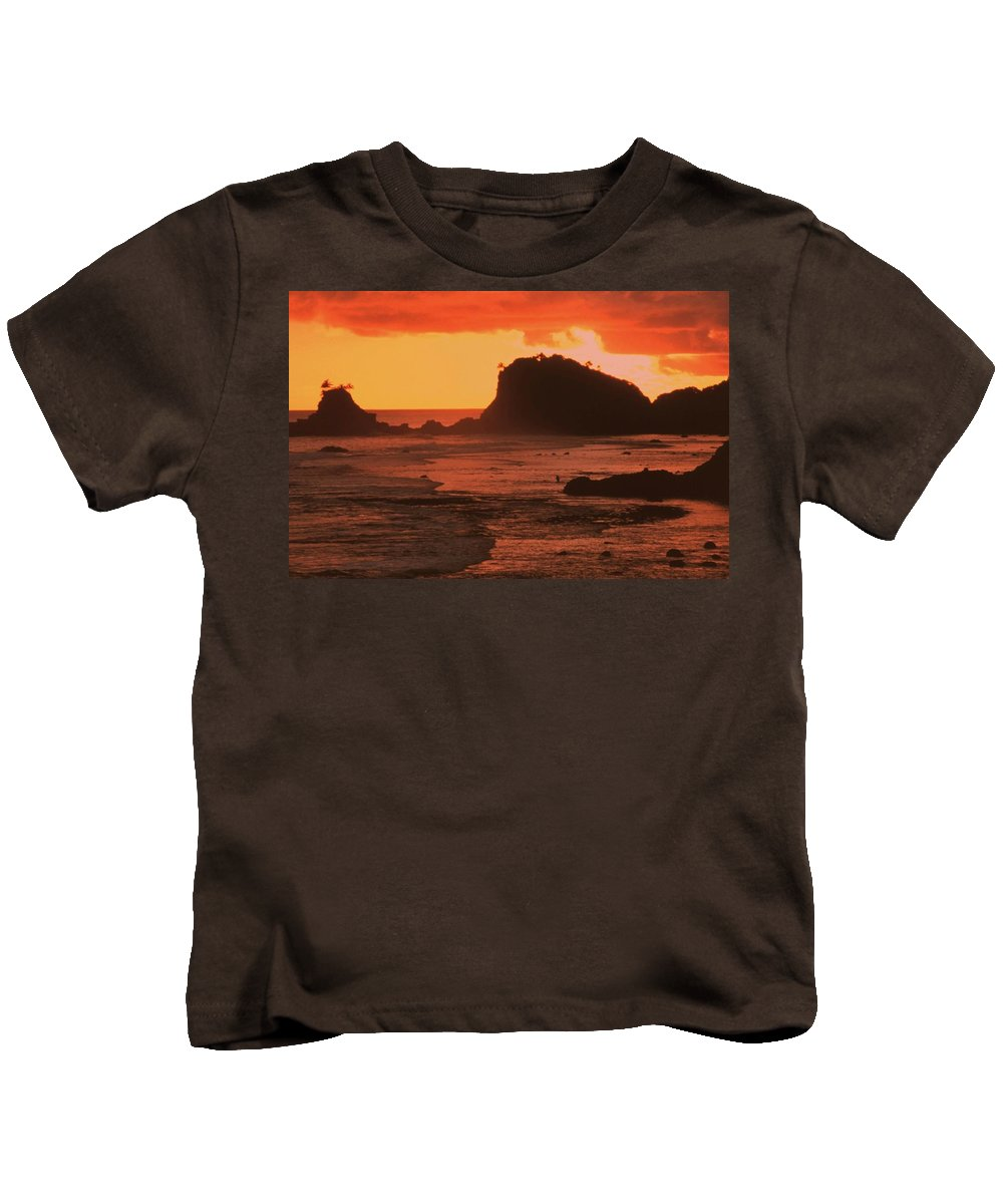 Sunset On Rocky Coast Kids T-Shirt featuring the photograph Sunset On A Rocky Coast by PhotographyAssociates