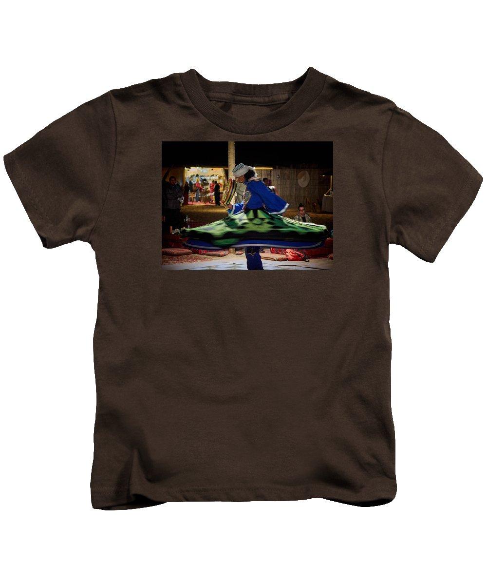 Al Maha Kids T-Shirt featuring the photograph Tanoura Dancer by Jouko Lehto