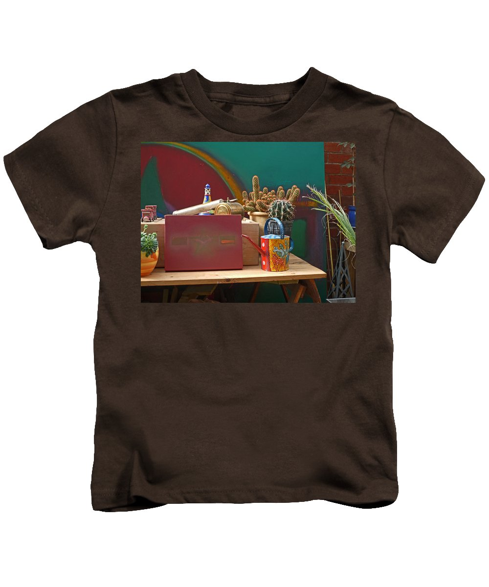 Garden Room Kids T-Shirt featuring the photograph The African Watering Can by Charles Stuart