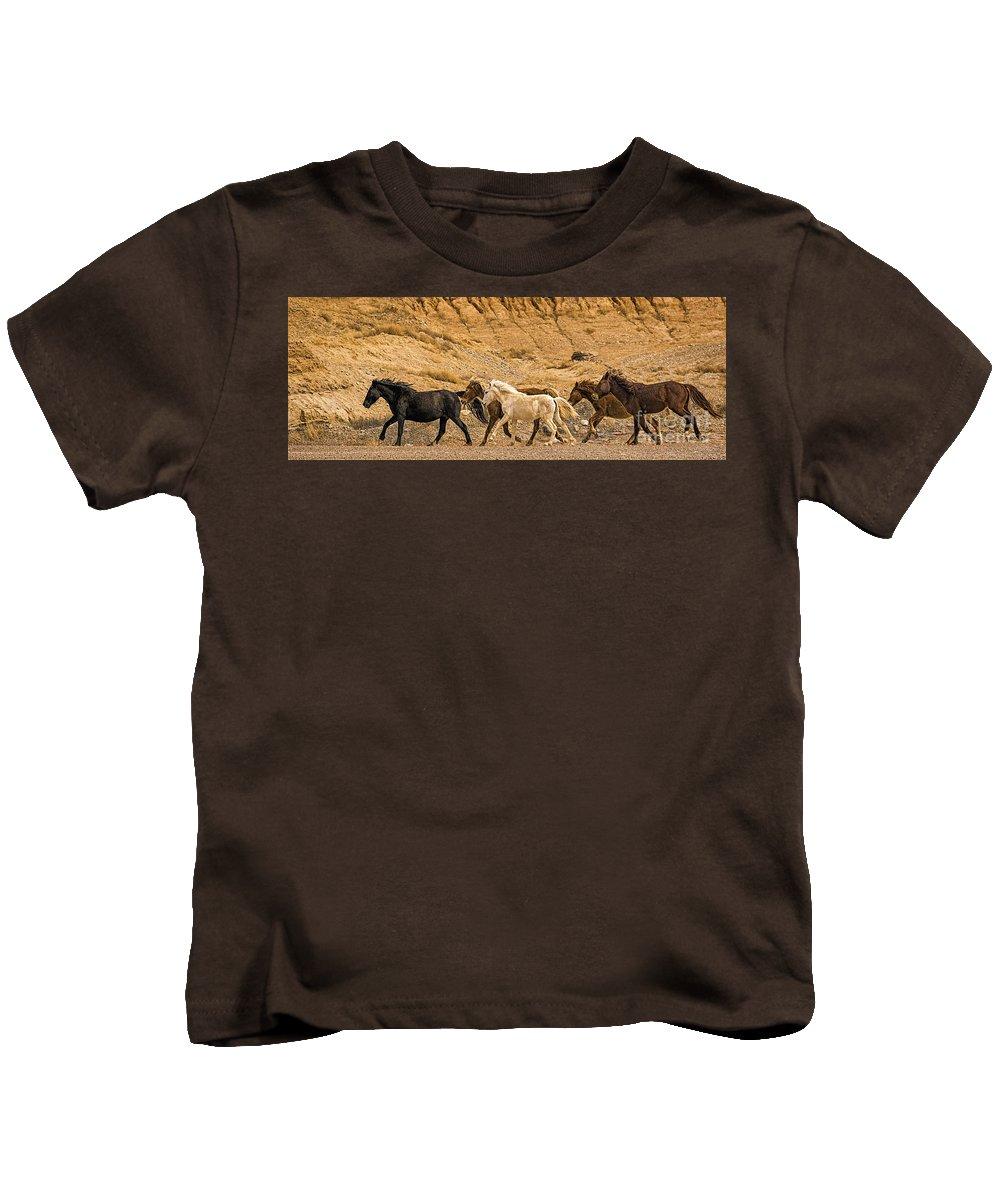 Ute Mountain Wild Horses On The Run Kids T-Shirt featuring the photograph Ute Mountain Wild Horses On The Run by Priscilla Burgers