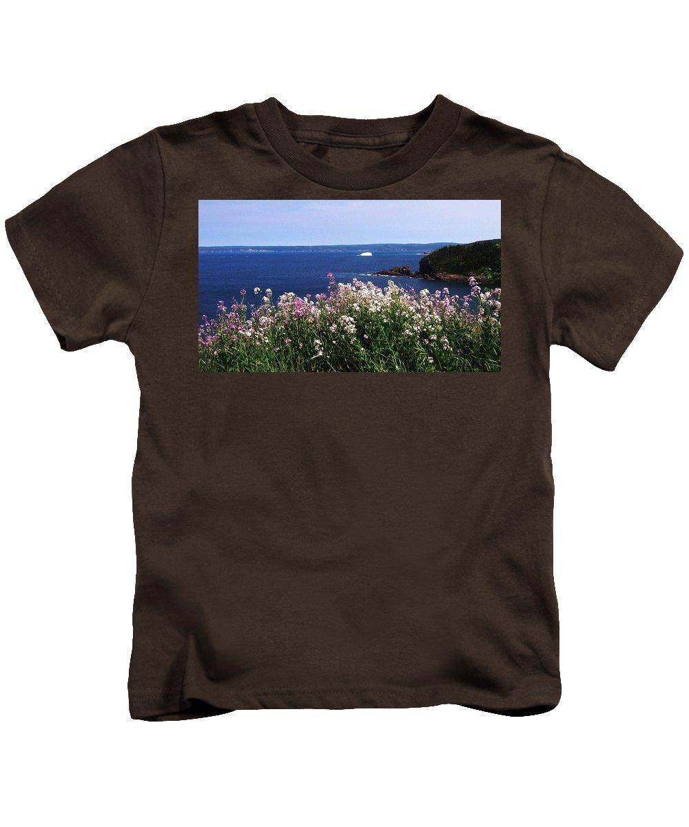 Photograph Iceberg Wild Flower Atlantic Ocean Newfoundland Kids T-Shirt featuring the photograph Wild Flowers And Iceberg by Seon-Jeong Kim