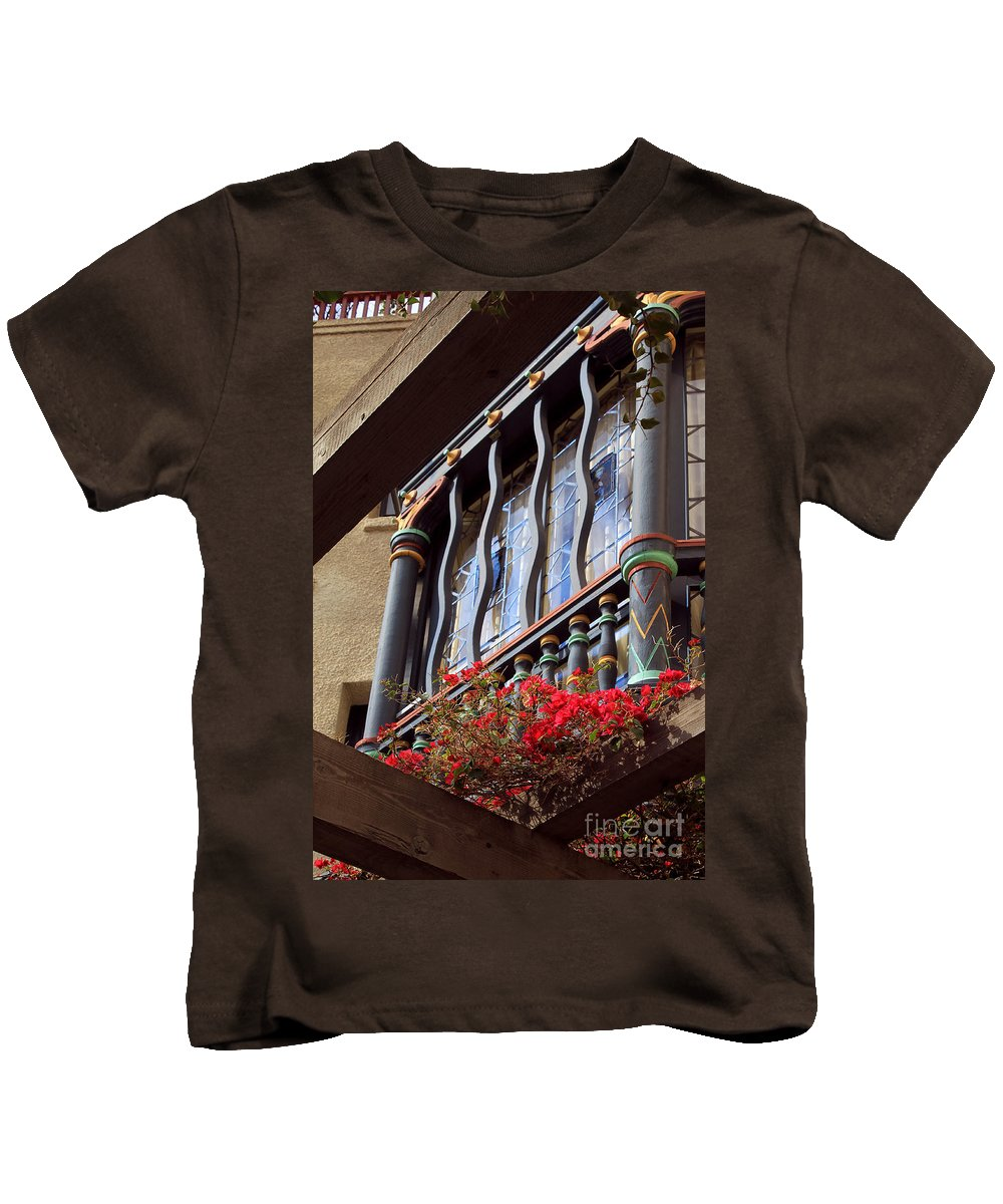 Architectural Kids T-Shirt featuring the photograph Wood Beams Red Flowers And Blue Window by James Eddy