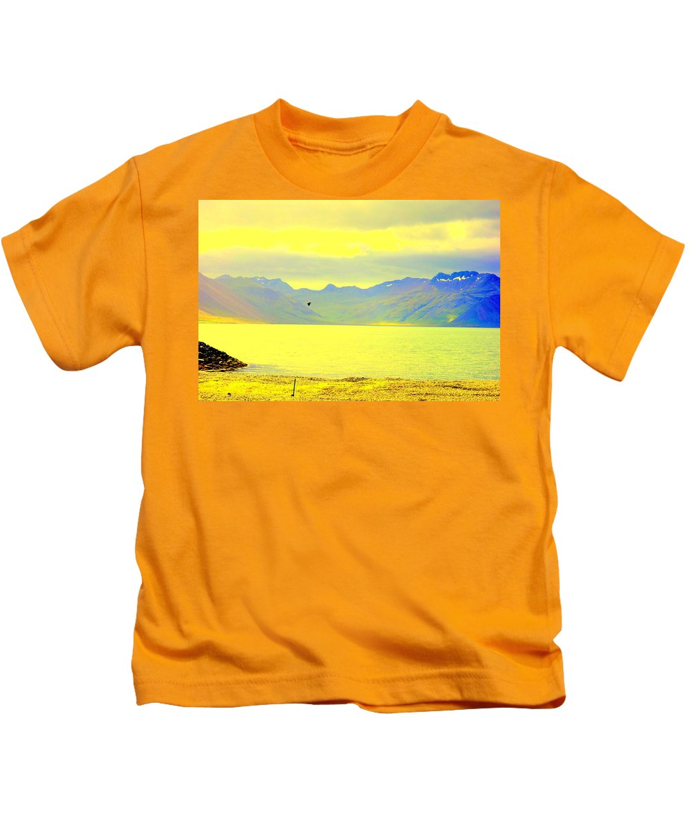 Seascape Kids T-Shirt featuring the photograph A Black Bird Is Crossing The Golden Landscape by Hilde Widerberg