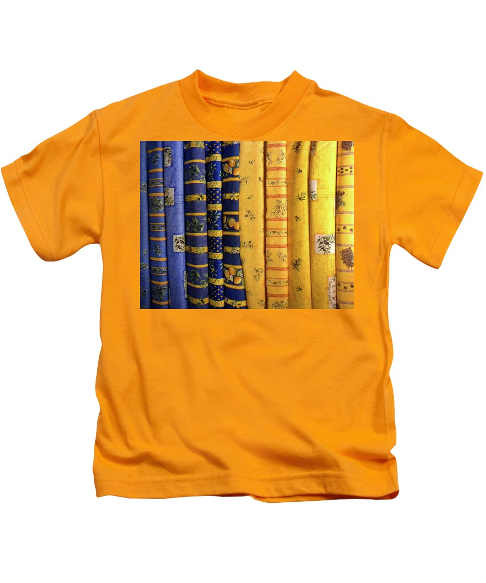Fabrics Kids T-Shirt featuring the photograph Fabrics From Provence by Dave Mills
