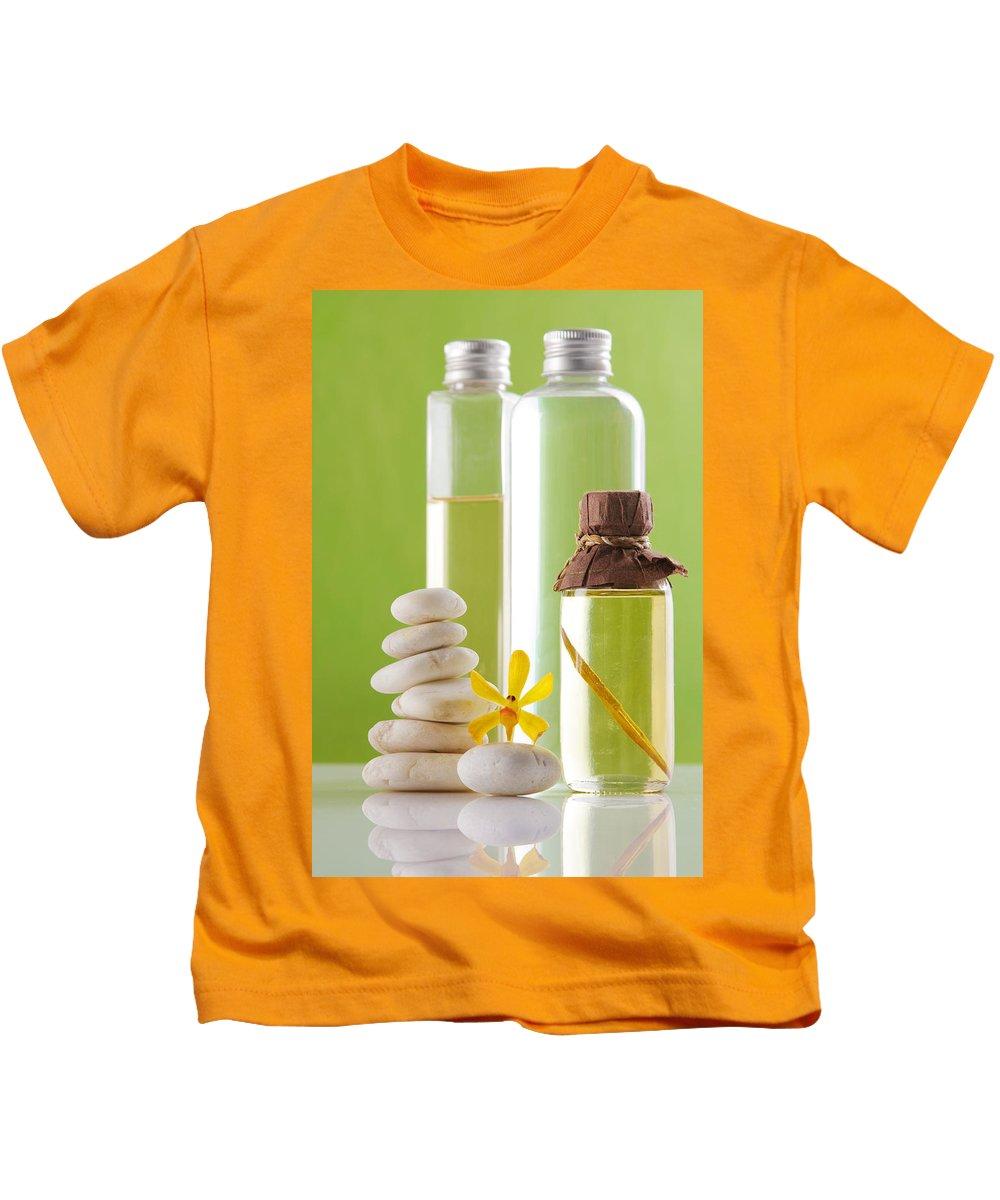 Spa-treatment Kids T-Shirt featuring the photograph Spa Oil Bottles by Atiketta Sangasaeng