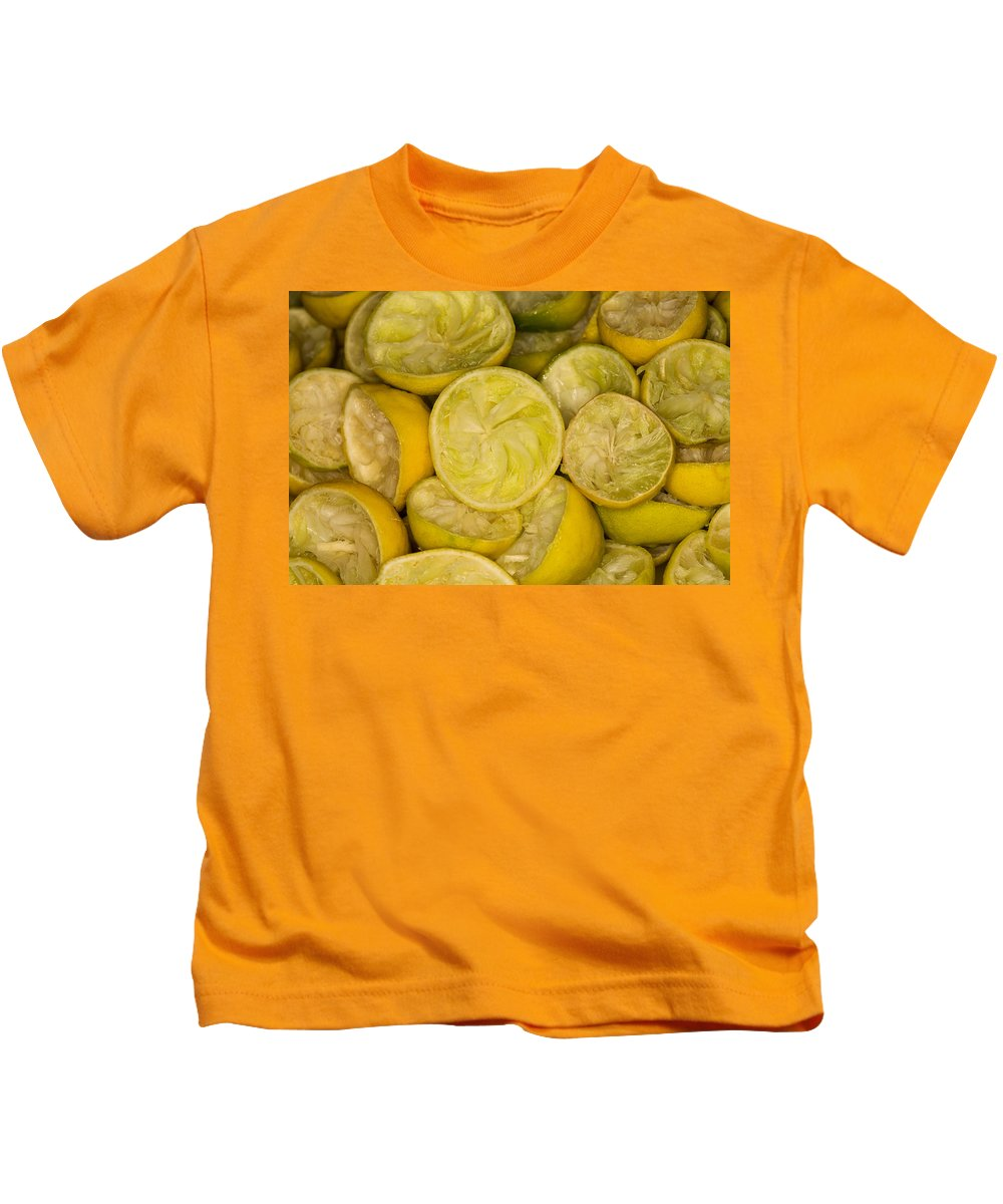 Absence Kids T-Shirt featuring the photograph Squeezed Key Lime Halves by Diane Macdonald