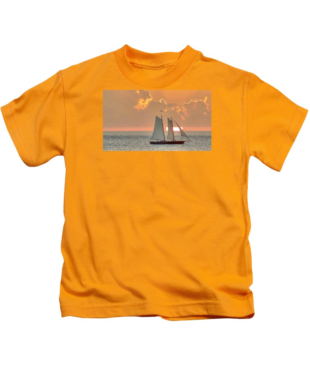 Key West Florida Sunset With The Sailboat America 2.0 Kids T-Shirt featuring the photograph Sunset America 2.0 by Mark Reinnoldt