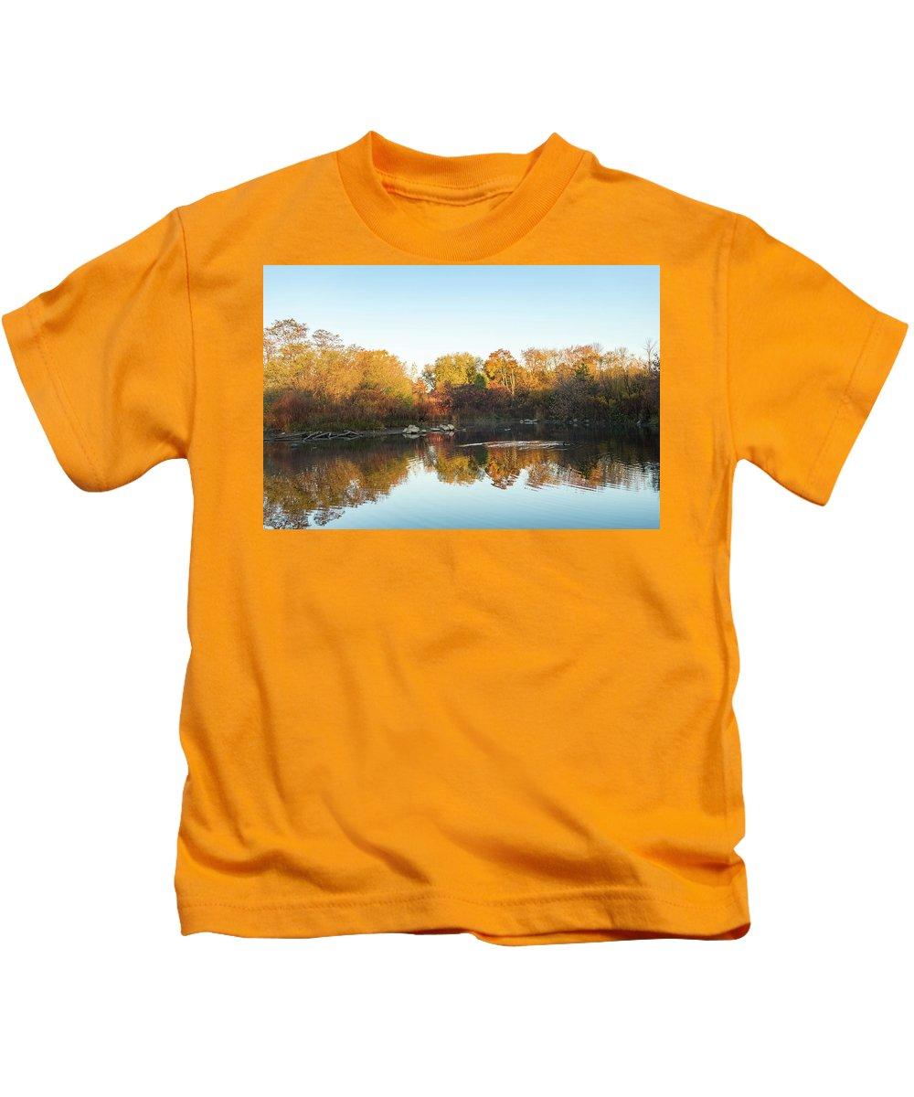 Autumn Mirror Kids T-Shirt featuring the photograph Autumn Mirror - Silky Wavelets Caused By Ducks by Georgia Mizuleva