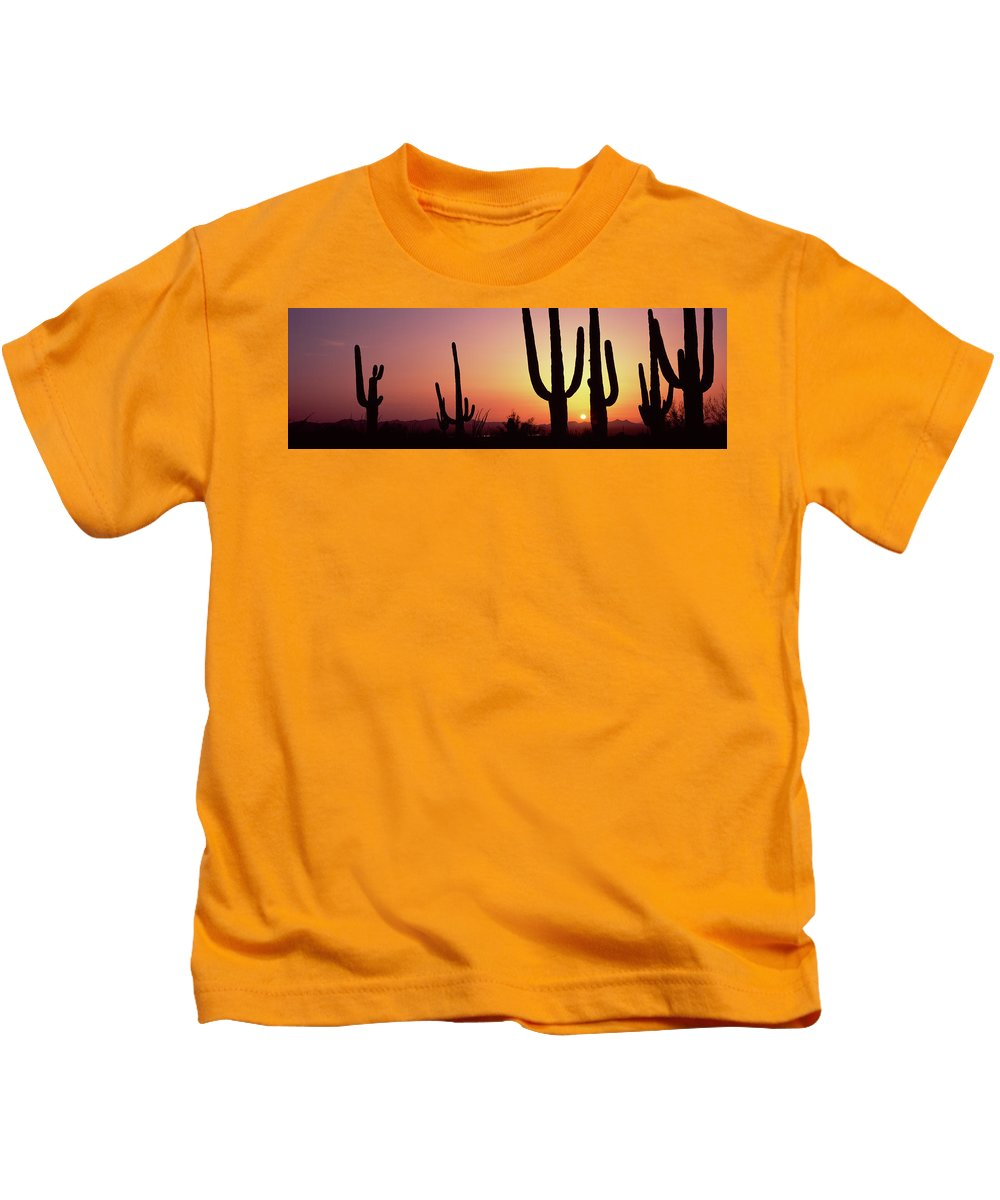 Photography Kids T-Shirt featuring the photograph Silhouette Of Saguaro Cacti Carnegiea by Panoramic Images