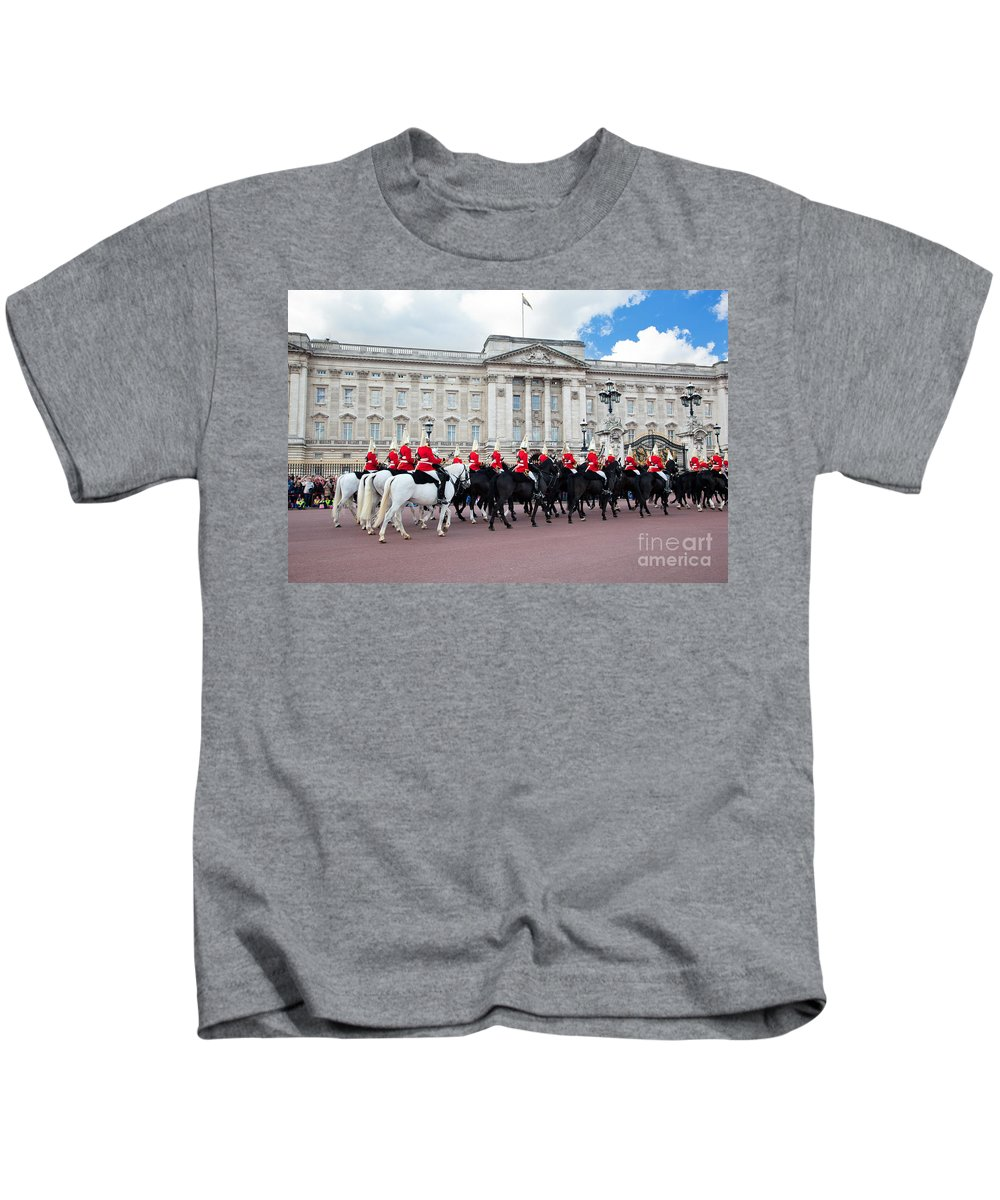 London Kids T-Shirt featuring the photograph British Royal Guards Perform The Changing Of The Guard In Buckingham Palace by Michal Bednarek