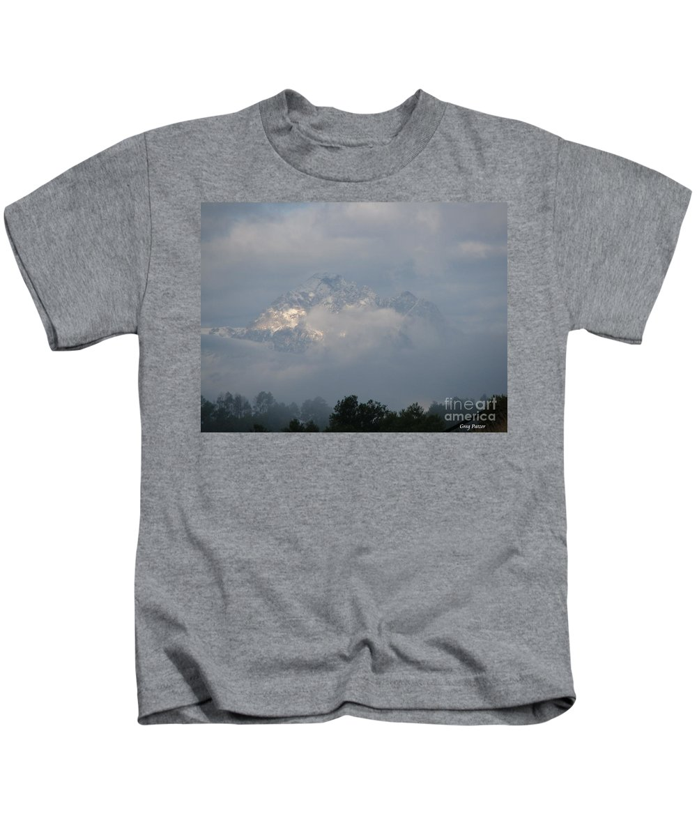 Rocky Mountains Kids T-Shirt featuring the photograph Out Of The Clouds by Greg Patzer