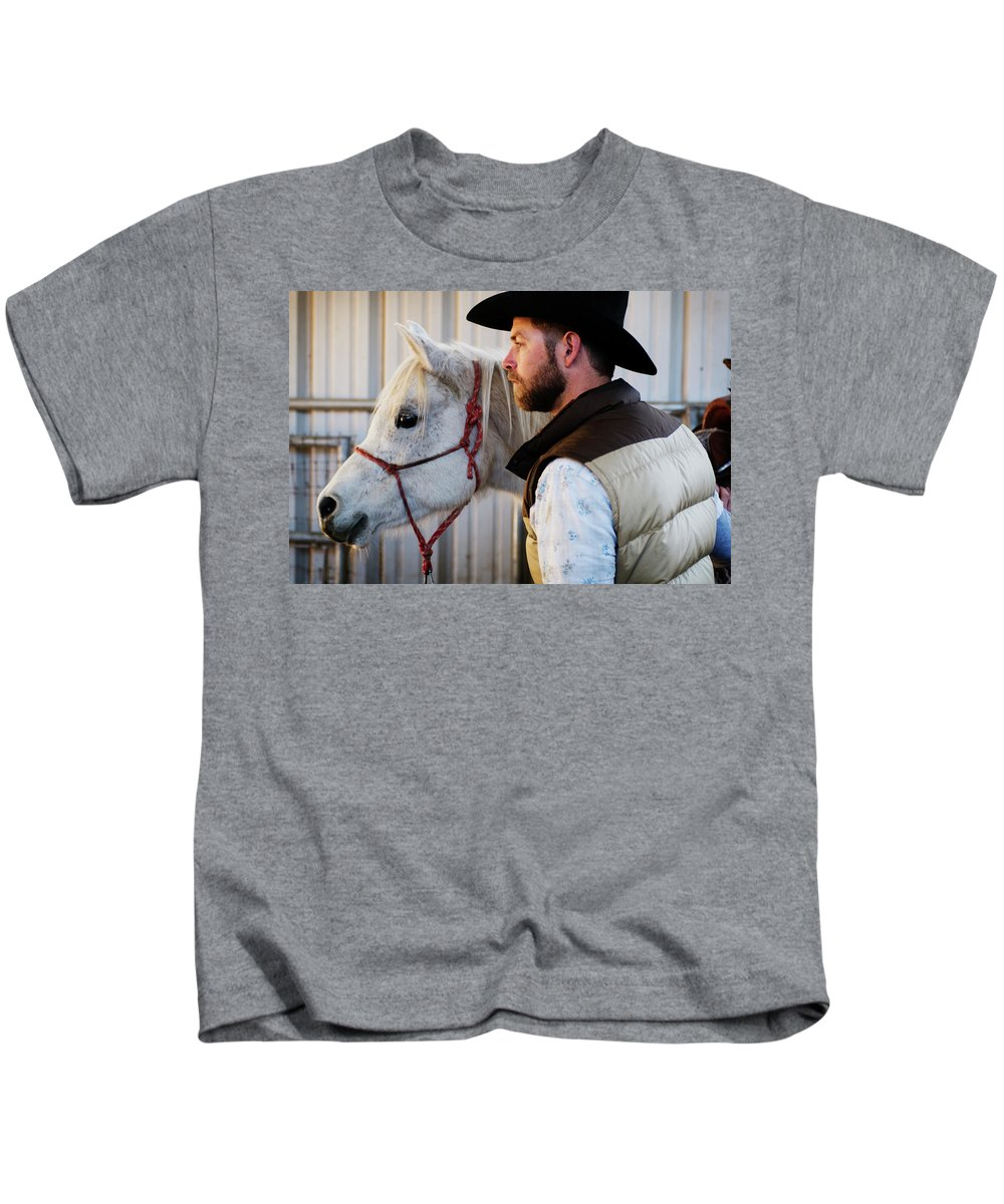 30s Kids T-Shirt featuring the photograph A Male Ranch Hand In A Cowboy Hat by Kyle George
