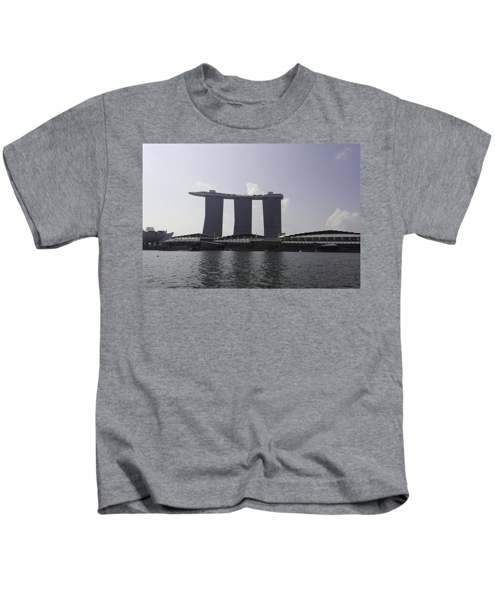3 Towers Kids T-Shirt featuring the photograph A View Of The Three Towers Of The Marina Bay Sands In Singapore by Ashish Agarwal