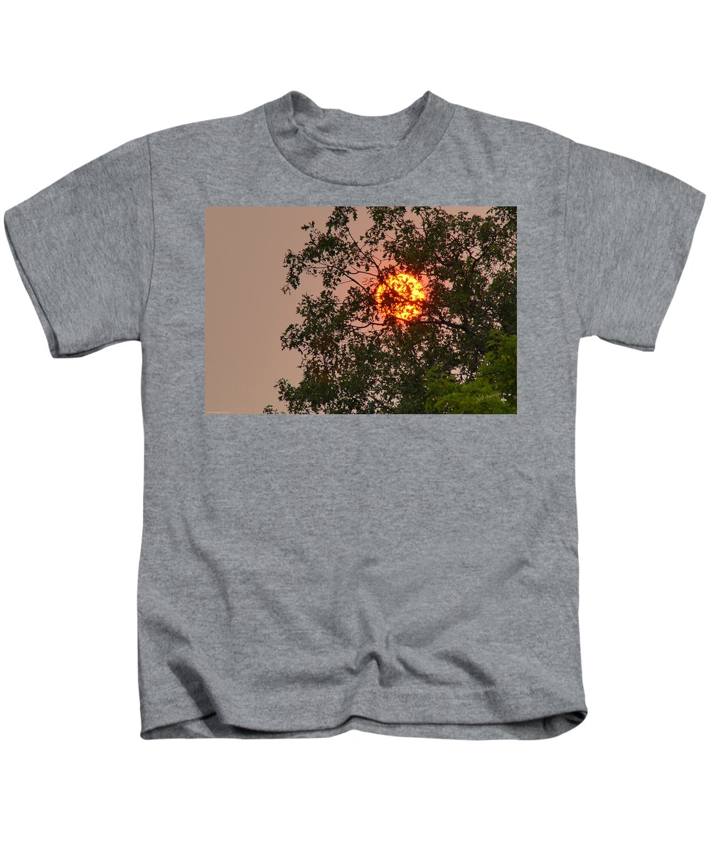 Blazing Kids T-Shirt featuring the photograph Blazing Sun Hiding Behind A Tree by Mick Anderson