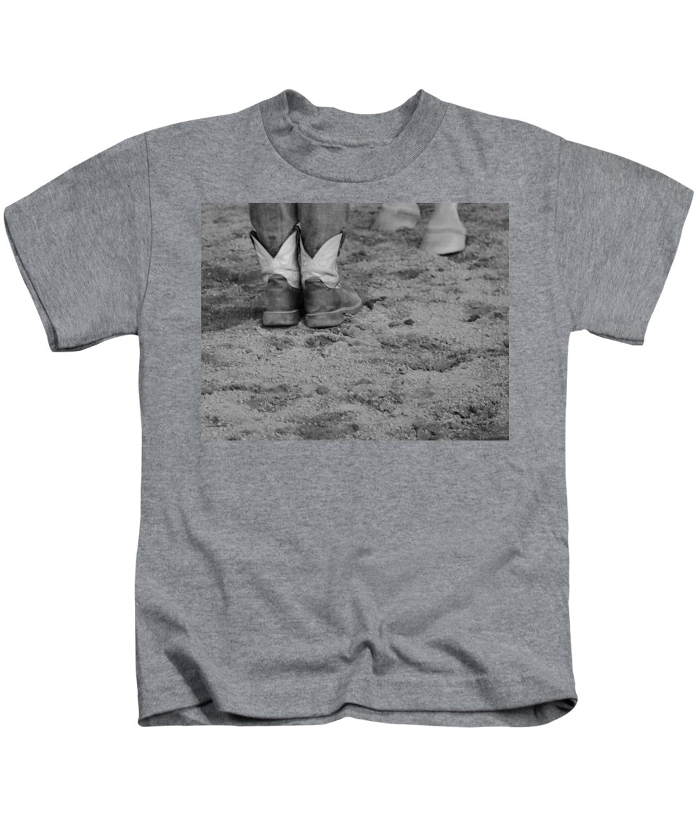 Boots And Horse Hooves Kids T-Shirt featuring the photograph Boots And Horse Hooves by Dan Sproul