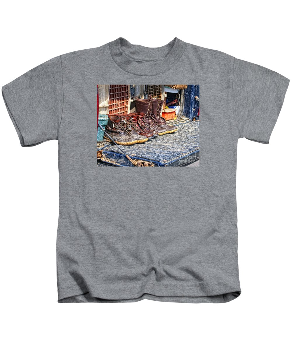 Hunting Kids T-Shirt featuring the photograph Boots Lined Up After The Hunt by Timothy Flanigan Debbie Flanigan Nature Exposure