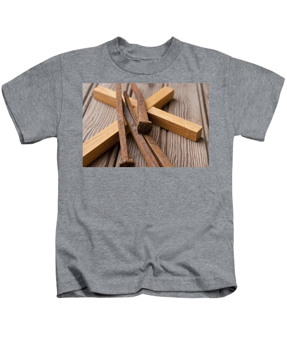 Religion Kids T-Shirt featuring the photograph Christian Cross And Rusty Nails by Donald Erickson