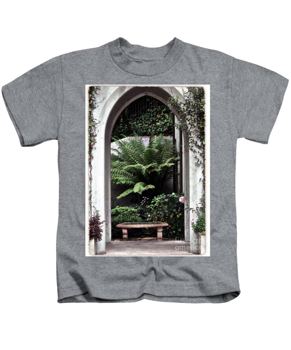 Courtyard.bench Kids T-Shirt featuring the photograph Church Courtyard by Kathleen Struckle