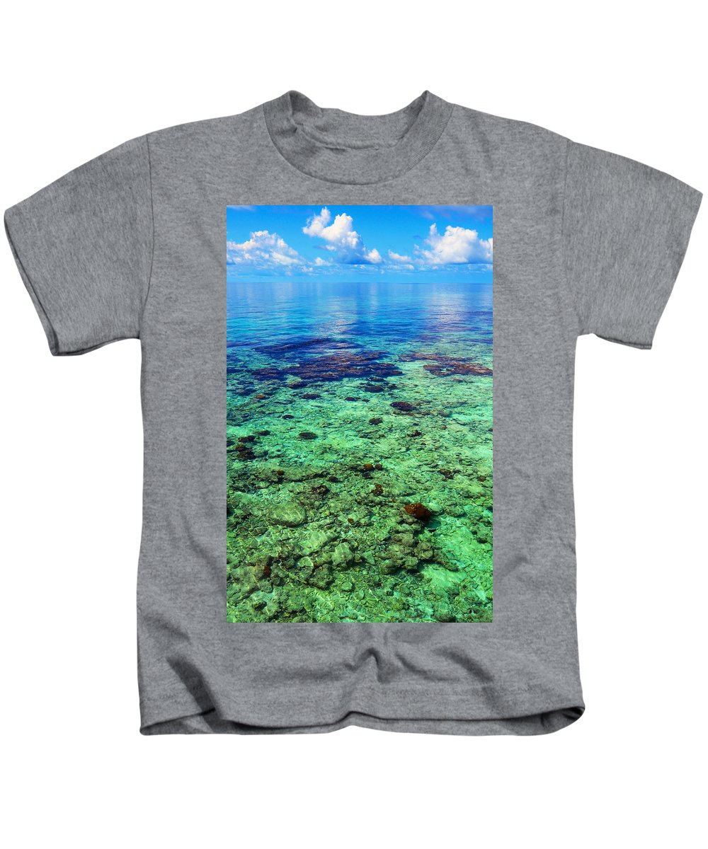 Tropic Kids T-Shirt featuring the photograph Coral Reef Near The Island At Peaceful Day. Maldives by Jenny Rainbow