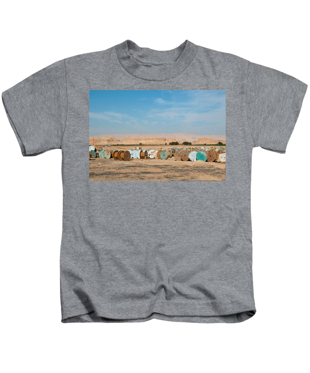 Empty Wire Spools Kids T-Shirt featuring the digital art Dakhla by Carol Ailles