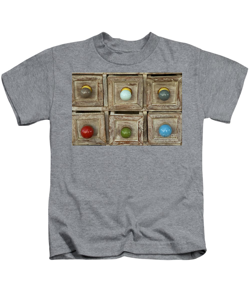 Market Day Lourmarin Markets Drawers Knob Drawer Knobs Still Live Provence Kids T-Shirt featuring the photograph Drawer Knobs by Bob Phillips