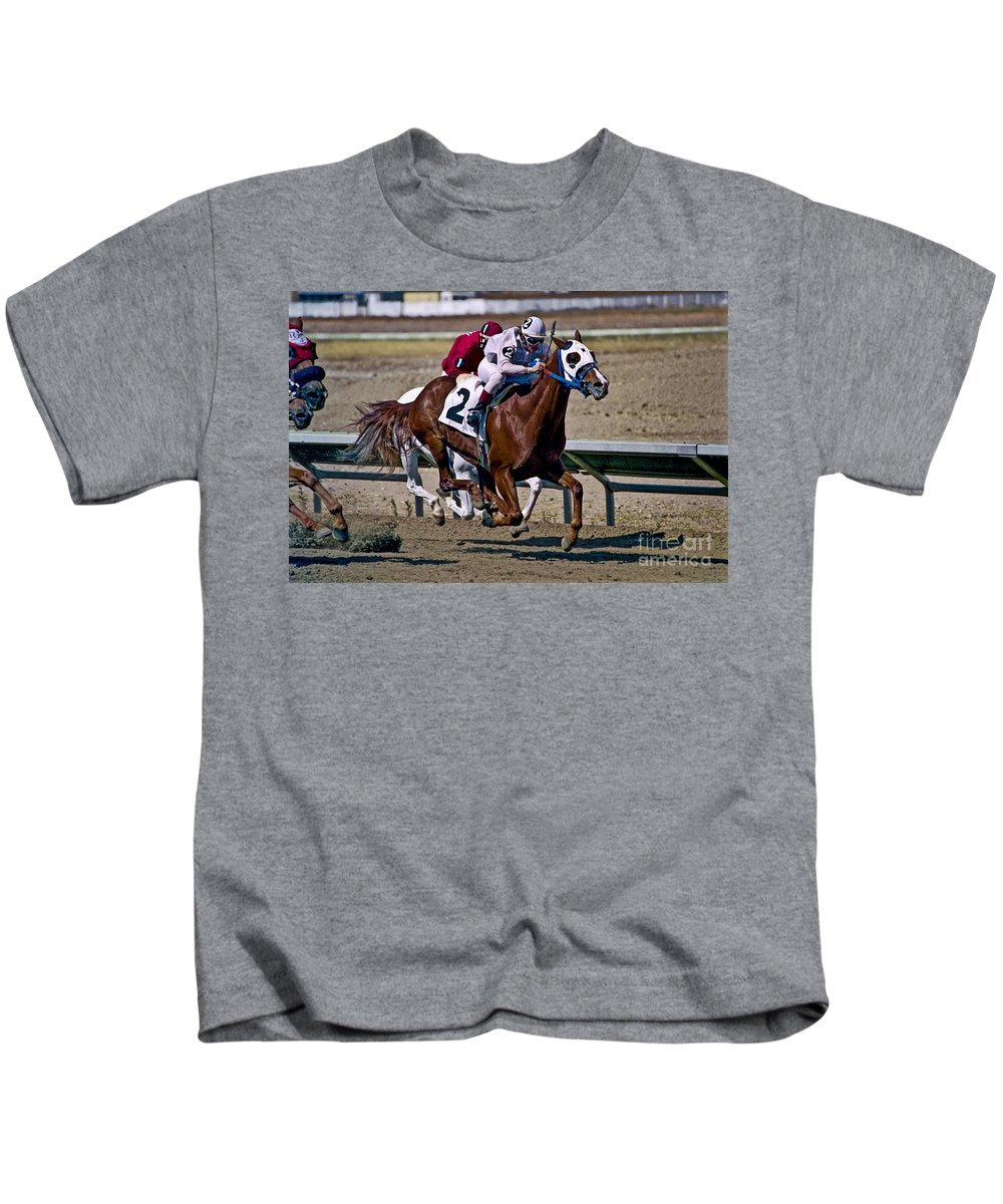 Racing Kids T-Shirt featuring the photograph Flying Hooves by Kathy McClure