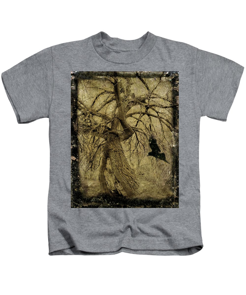 Gnarled Tree Kids T-Shirt featuring the photograph Gnarled And Twisted Tree With Crow by Gothicrow Images