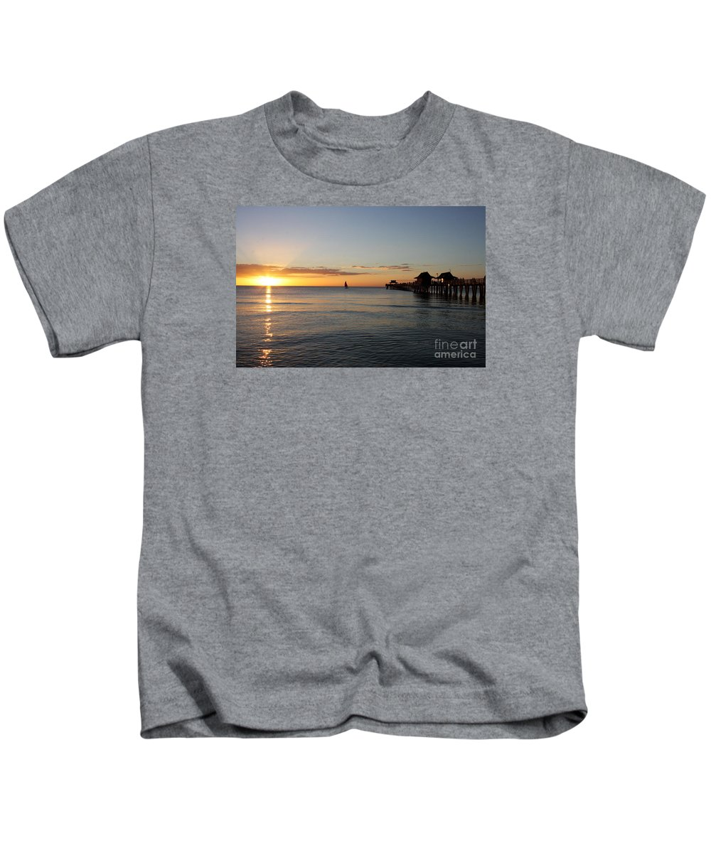 Sailing Kids T-Shirt featuring the photograph Golden Hour At Naples Pier by Christiane Schulze Art And Photography