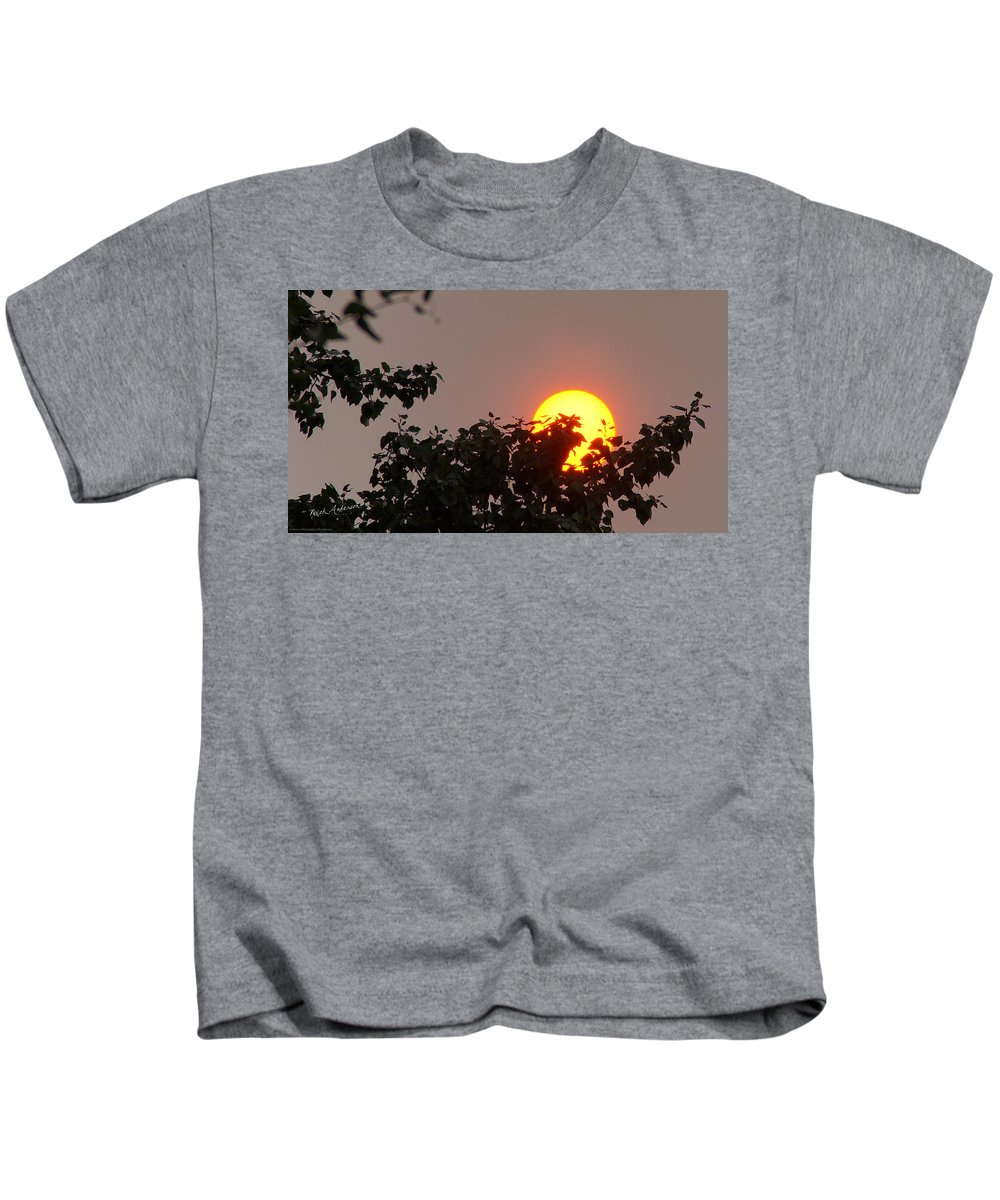 Sun Kids T-Shirt featuring the photograph Leaves Cradling Setting Sun by Mick Anderson