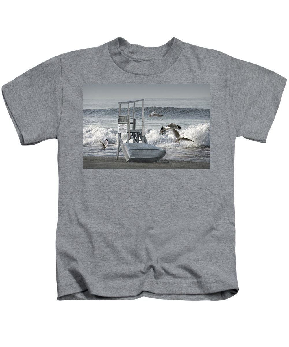Station Kids T-Shirt featuring the photograph Lifeguard Station With Flying Gulls At A Lake Huron Beach by Randall Nyhof