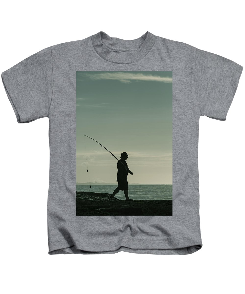 Ocean Kids T-Shirt featuring the photograph Lone Fisherman In Silhouette by Russ Dixon
