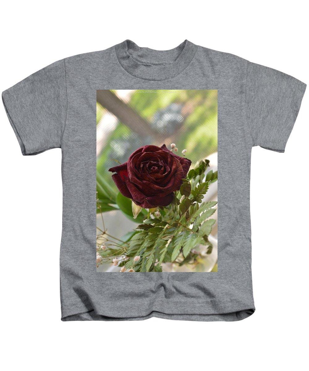 Marasmic Beauty Kids T-Shirt featuring the photograph Marasmic Charm by Sonali Gangane