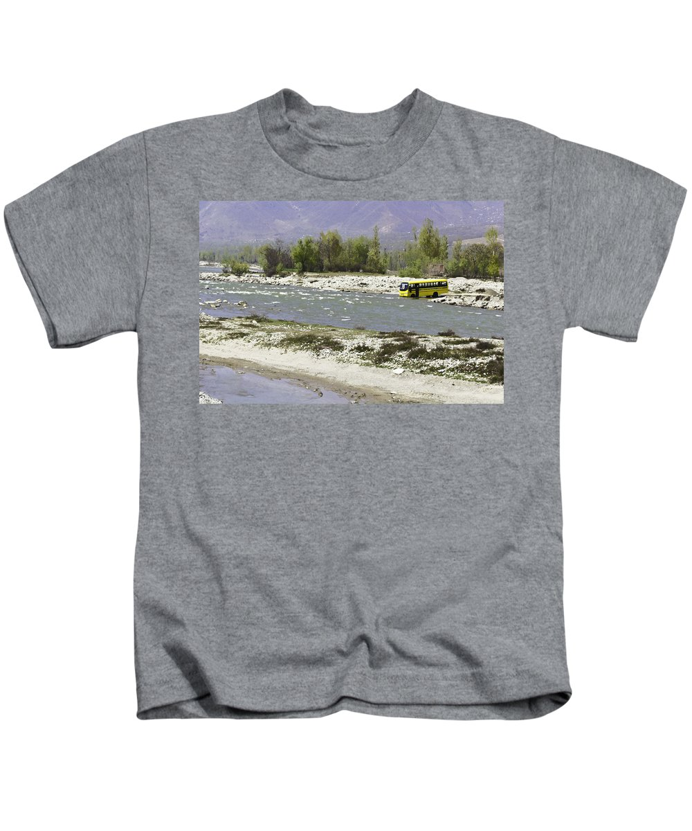 Boulders Kids T-Shirt featuring the digital art Oil Painting - Front Part Of School Bus In A Mountain Stream On The Outskirts Of Srinagar by Ashish Agarwal