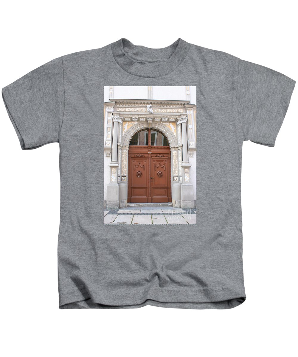 Door Kids T-Shirt featuring the photograph Old Entrance Door With Lionheads by Christiane Schulze Art And Photography