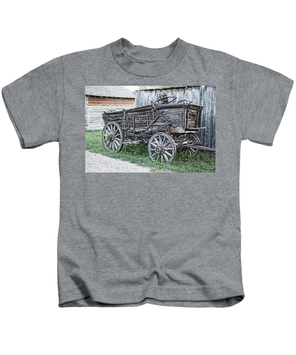 Wagon Kids T-Shirt featuring the photograph Old Freight Wagon - Montana Territory by Daniel Hagerman