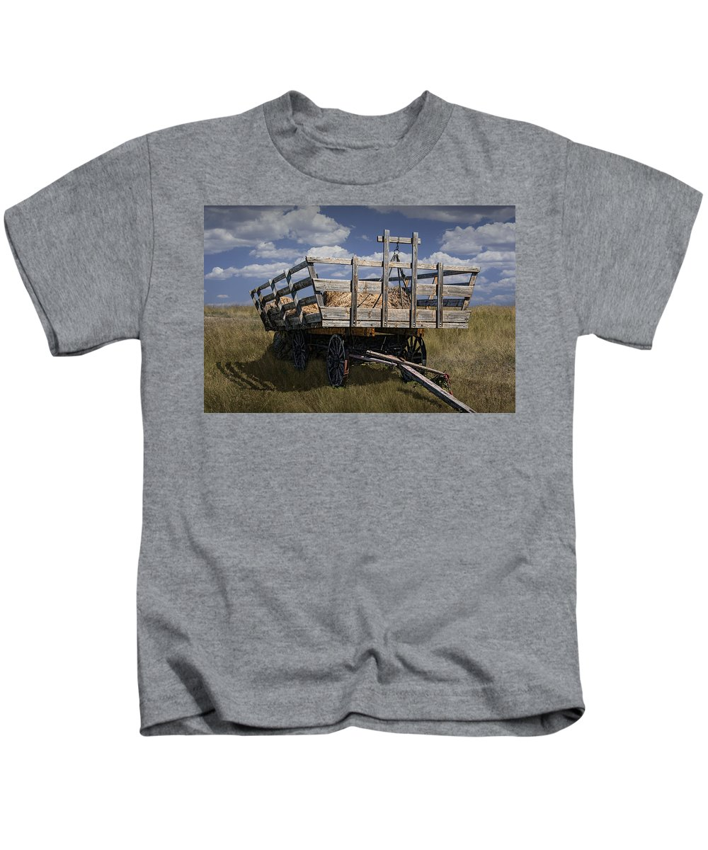Art Kids T-Shirt featuring the photograph Old Hay Wagon In The Prairie Grass by Randall Nyhof