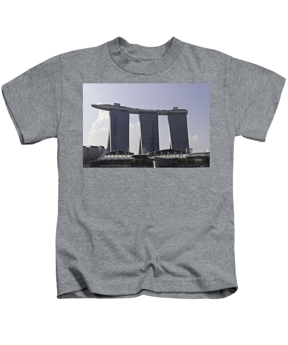 3 Towers Kids T-Shirt featuring the photograph Partial View Of The Artscience Museum And The Marina Bay Sands by Ashish Agarwal