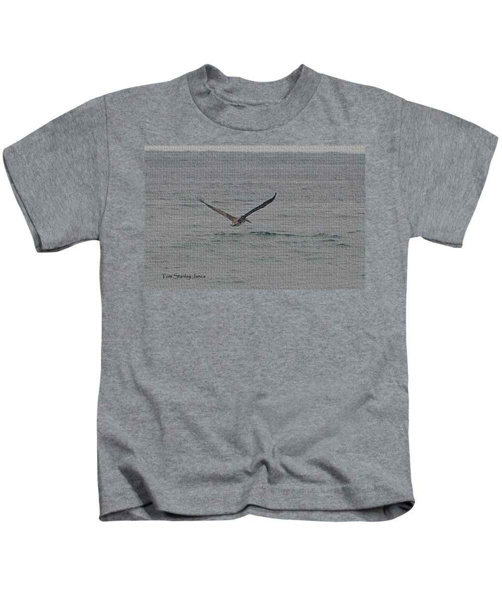 Pelican Flying Low Kids T-Shirt featuring the photograph pelican Flying Low by Tom Janca