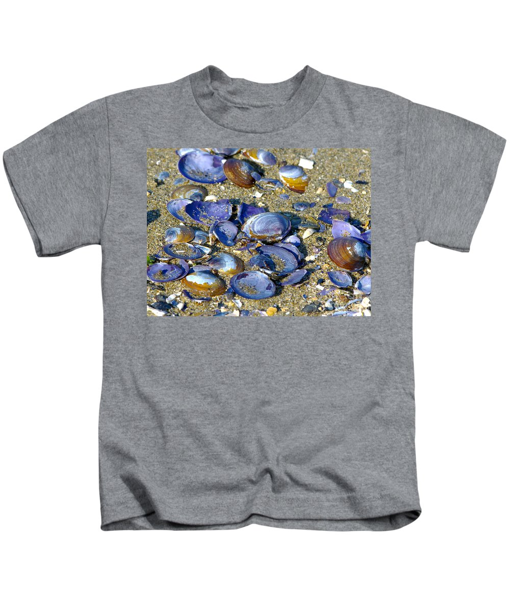Purple Clam Shells Kids T-Shirt featuring the photograph Purple Clam Shells On A Beach by Sharon Talson