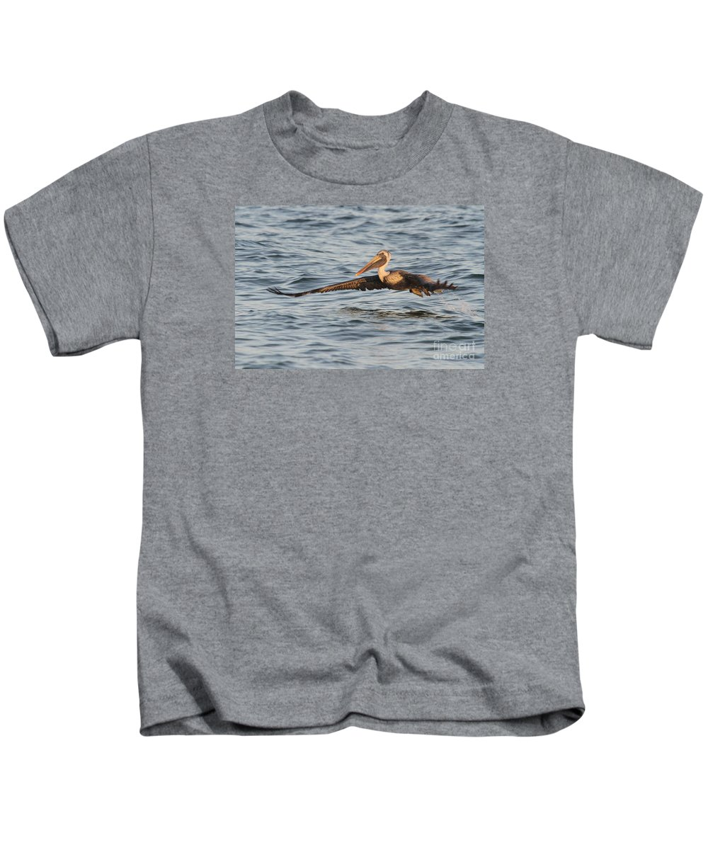 Pelican Kids T-Shirt featuring the photograph Skim Over The Sea by Christiane Schulze Art And Photography