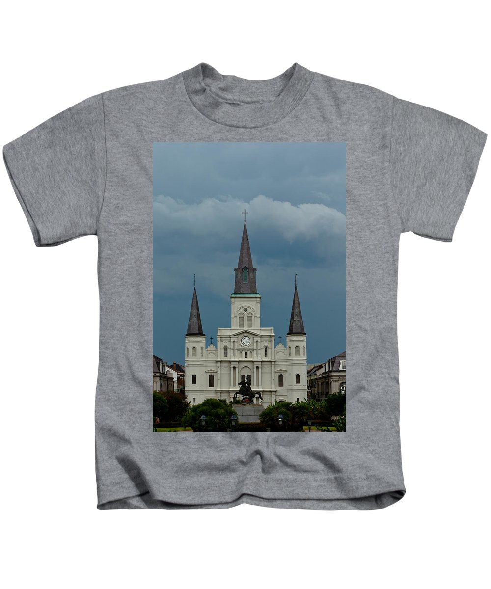 Louisiana Kids T-Shirt featuring the photograph St Louis Cathedral Under Storm Clouds by Susie Hoffpauir
