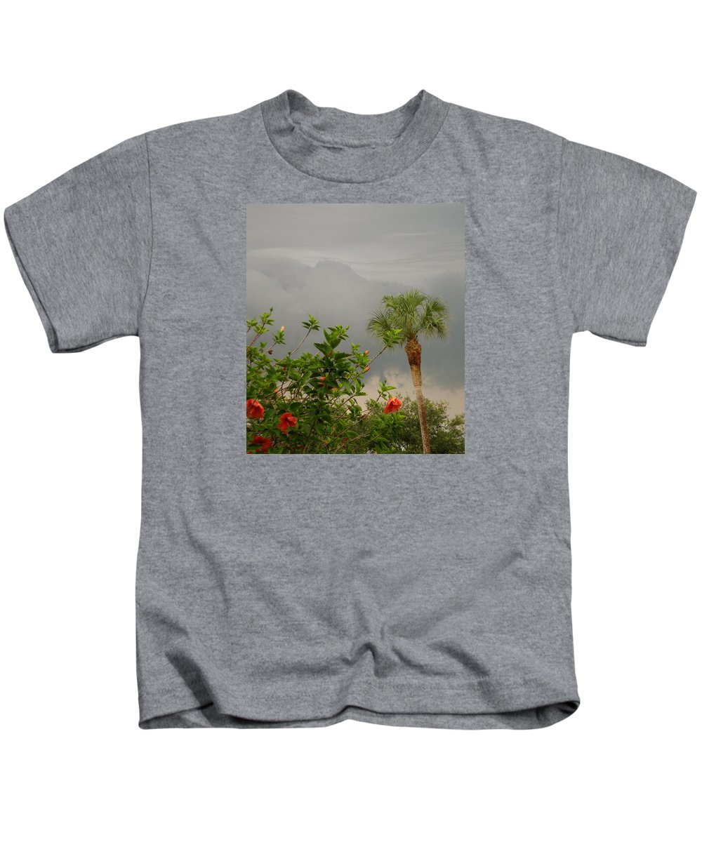 Sunrise Kids T-Shirt featuring the photograph Storm Clouds And Flowers by Janet K Wilcox
