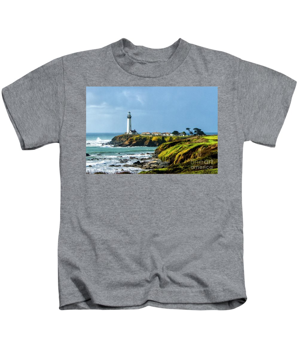 Beach Kids T-Shirt featuring the photograph Stormy Lighthouse by Nicholas Pappagallo Jr