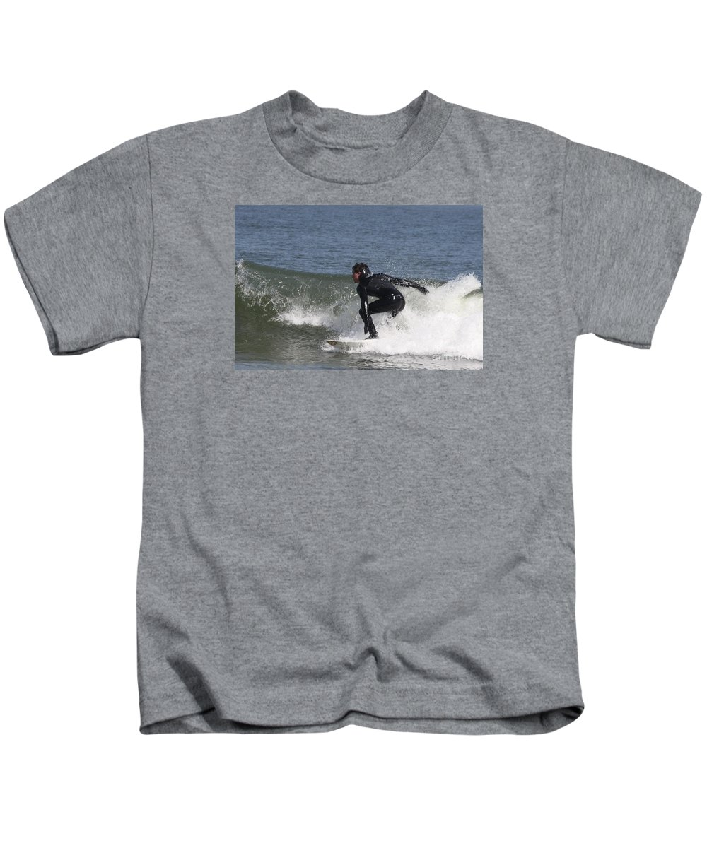 Surfer Hitting The Curl Kids T-Shirt featuring the photograph Surfer Hitting The Curl by John Telfer
