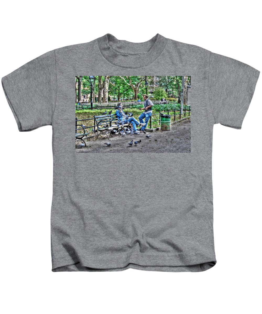 Washington Square Park Kids T-Shirt featuring the photograph The Bird Whisperer by Randy Aveille