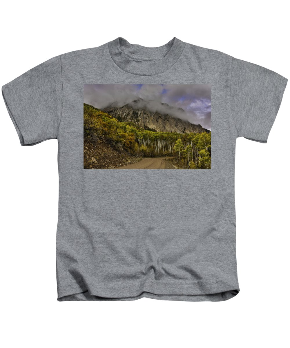 Autumn Landscape With Mountain Backdrop And Stormy Weather Kids T-Shirt featuring the photograph The Road To Glory by Bill Sherrell