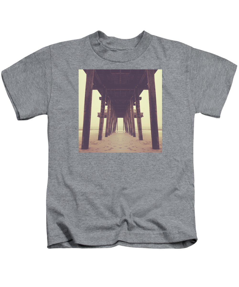 Ocean Kids T-Shirt featuring the photograph Under The Pier by Chris Pignatelli